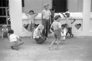 French Village, a small settlement on St. Thomas Island, Virgin Islands. Boys playing marbles outside of a general store.Delano, Jack, photographer. CREATED/PUBLISHED 1941 Dec.